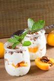Fresh yogurt with  loquats Royalty Free Stock Photos