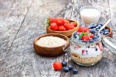 Fresh yogurt with oat flakes and berries Stock Photo