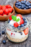 Fresh yogurt with oat flakes and berries Stock Photos