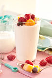 Fresh yogurt with raspberries and mango stock image