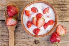 Fresh yogurt with strawberry on wooden Royalty Free Stock Photos