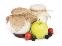 Fresh yogurts in jars Royalty Free Stock Images