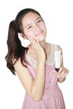 Fresh young asian woman taking moisturizer cream Stock Photos