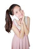 Fresh young asian woman taking moisturizer cream. On white background Stock Photos
