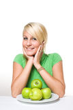 Fresh young blond with fresh green apples. Royalty Free Stock Image