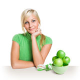 Fresh young blond with fresh green apples. Stock Photo