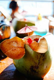 Fresh young coconut at the tropical beach resort in Asia, hot summer holiday Stock Image