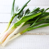 Fresh young garlic on white boards Royalty Free Stock Photo
