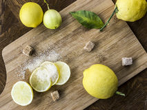 Fresh young lemons with sugar Stock Photography