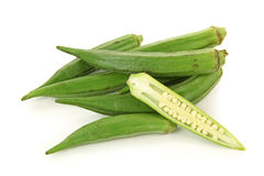 Fresh young okra. Isolated on white background Royalty Free Stock Images
