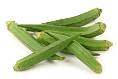 Fresh young okra. Isolated on white background Royalty Free Stock Photos