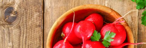 Fresh young radish on wooden old table boards. Fresh young radish on wooden old boards Royalty Free Stock Photo