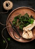 Fresh young stinging nettle leaves on a wooden pate. royalty free stock photo