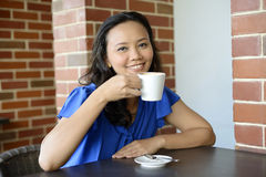 Fresh Young woman in Cafe Royalty Free Stock Image