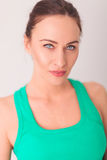 Fresh young woman in green undershirt. In studio Royalty Free Stock Image
