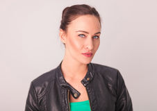 Fresh young woman in leather jacket. Posing in studio Royalty Free Stock Images
