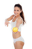 Fresh young woman in underwear with a apple Stock Images