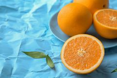 Fresh yummy oranges. On color paper background Stock Photo