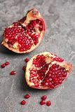Fresh yummy pomegranate. On grey table Royalty Free Stock Photography