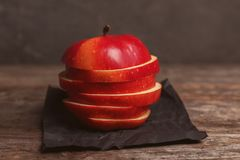 Fresh yummy sliced apple. On wooden table Royalty Free Stock Photo