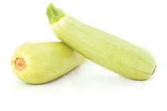 Fresh zucchini. Zucchinis on the wooden cutting board royalty free stock photo
