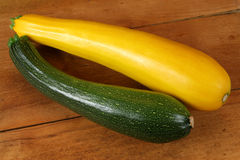Fresh zucchini. Zucchini - fresh yellow and green vegetables on the old board Stock Images