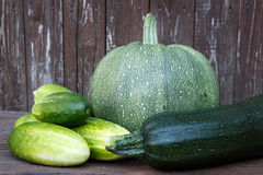 Fresh zucchini and cucumbers on the wooden table Stock Photo