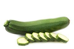 Fresh zucchini (Cucurbita pepo) and some cut pieces Stock Photography