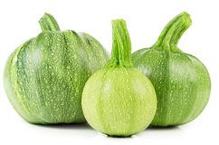 Fresh zucchini. Raw courgettes isolated on white background. Fresh zucchini Stock Images