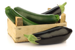 Fresh zucchini's and eggplant in a wooden box Stock Image