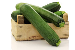 Fresh zucchini's in a wooden box Royalty Free Stock Photos