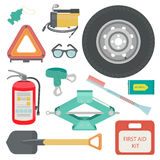 Freshener, sunglasses, wet wipes, tow rope, first aid kit, fire extinguisher, spare wheel, shovel, brush and scraper. Stock Images