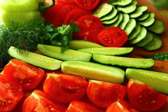 Freshest cucumbers and tomatoes to eat. Are beautifully fresh tomatoes and cucumbers to eat Stock Images