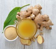 Freshginger,ginger juice and capsules on wooden. Freshginger,ginger juice and capsules on a wooden stock images