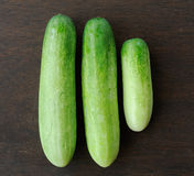 Freshgreen cucumber on wood Royalty Free Stock Images