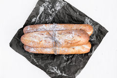 Freshly backed baguettes on a dark paper Royalty Free Stock Image