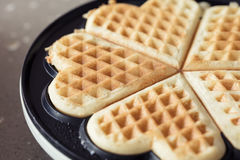 Freshly backed waffles in shape of heart, close up Royalty Free Stock Photo