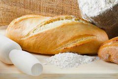 Freshly baguette and bread on cutting board Royalty Free Stock Photo