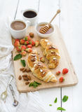 Freshly baked almond croissants with garden Stock Photo