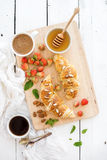 Freshly baked almond croissants with garden Stock Photography