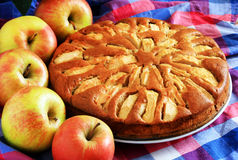Freshly baked apple pie with apples in the. Background Royalty Free Stock Photography