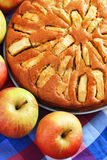 Freshly baked apple pie with apples in the. Background Stock Photography