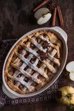 HomemadeFreshly baked apple pie with apples in the background. Macro with shallow dof. Freshly baked apple pie with apples in the background. Macro with shallow Royalty Free Stock Photography