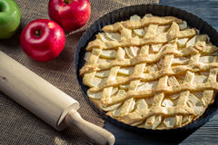Freshly baked apple pie with rolling pin Stock Images