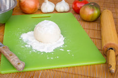 Freshly baked artisan pizza with fresh produce and cheese. Royalty Free Stock Photos