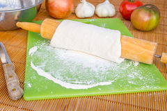 Freshly baked artisan pizza with fresh produce and cheese. Stock Photography