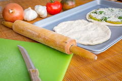 Freshly baked artisan pizza with fresh produce and cheese. Royalty Free Stock Photo
