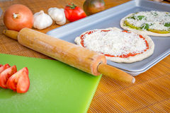 Freshly baked artisan pizza with fresh produce and cheese. Stock Photo