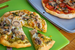 Freshly baked artisan pizza with fresh produce and cheese. Royalty Free Stock Photography