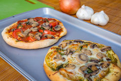 Freshly baked artisan pizza with fresh produce and cheese. Royalty Free Stock Images